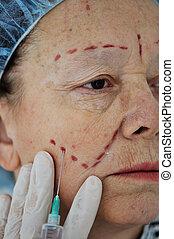 Senior woman getting botox injection at hospital