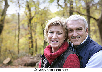 Couple strolling in the forest