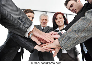 Group of business people with hands together for unity and...