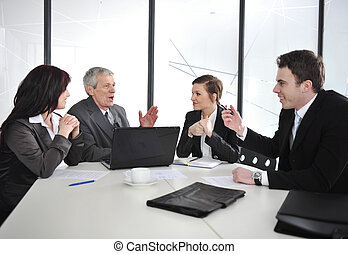 Group of business people having a discussion in office -...