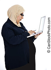 Pregnant Muslim Arabic woman using laptop