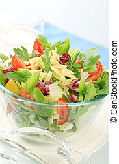 Vegetable salad sprinkled with grated cheese - detail