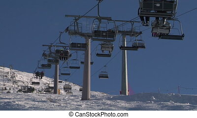 chair lift 03 - Chair ski lift with skiers over