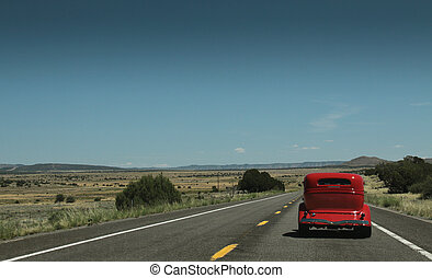 Red Car on the Route 66 - an old red car on the famous route...