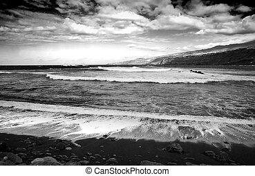 Rough sea, black and white - A beach at Puerto de la Cruz,...