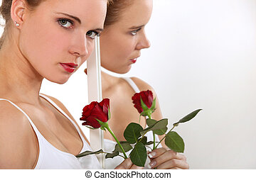 Gorgeous model with a red rose