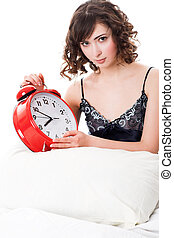 Woman with alarm clock