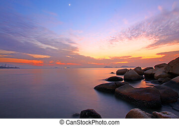 Sunset over the ocean. Nature composition under long exposure.