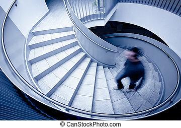 Man walk upstairs - Man in motion blur walking up steps