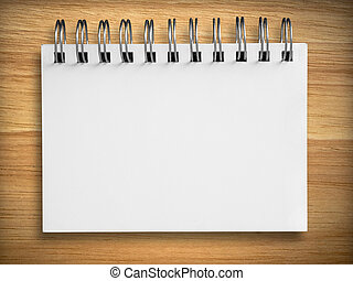White notebook on Rubber wood