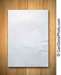 White crumpled paper - blank white paper on rubber wood...