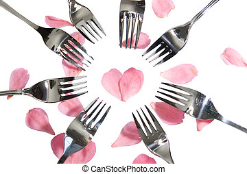 forks surrounding heart shape with rose petals