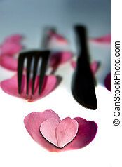 knife and fork with heart shaped rose petals