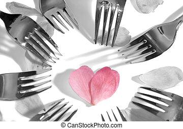 dark forks surrounding heart shape and rose petals - forks...