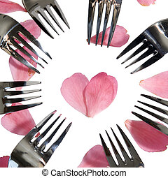 forks surrounding heart shape and rose petals