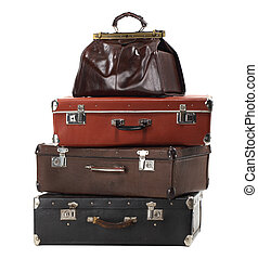 Old vintage suitcases isolated on white. Luggage