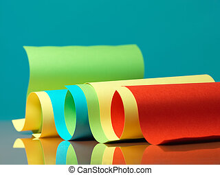 curved, colorful sheets of paper with reflexions