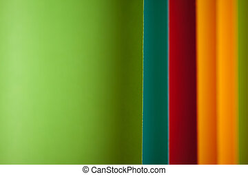 detail of curved, colored sheets of paper - background image...