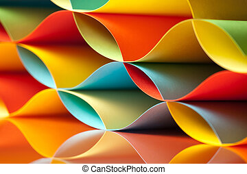 curved, colorful sheets paper with mirror reflexions -...