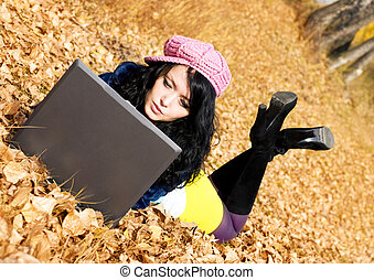 pretty girl with a laptop outdoor - pretty brunette girl...