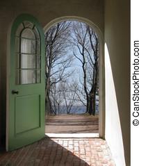 Doorway to bare trees