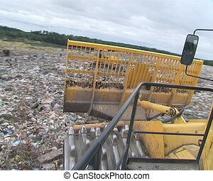 Riding dump rubbish pressing truck. Environmental pollution....