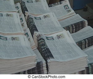work printing newspaper - Printing house worker is working...