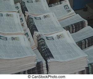 work printing newspaper - Printing house worker is working...