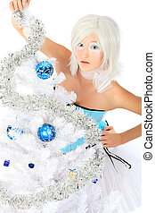 blue balls - An artistic blonde model posing with Christmas...