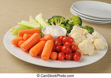Vegetable tray - A party plate loaded with vegetables and...