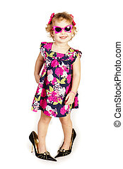 Beautiful little girl in high-heeled shoes over white...