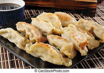Potstickers stuffed with chicken and vegetables