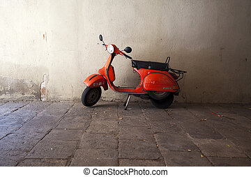 Red motorbike in the old town of Barcelona - Spain