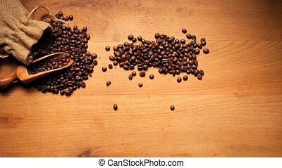 Roasted Coffee Beans On Wood - Freshly roasted coffee beans...