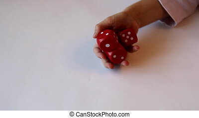 dice - The child throws the dice