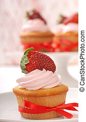 Delicious Vanilla cupcake with strawberry frosting