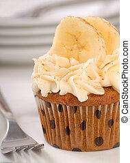 Delicious carrot cake cupcake with cream cheese frosting,...