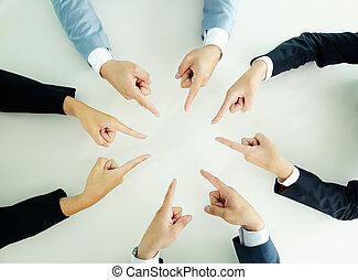Pointing hands - Top view of businesspeople pointing at each...