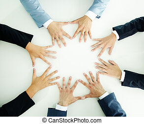 Hands of businesspeople - Top view of businesspeople holding...
