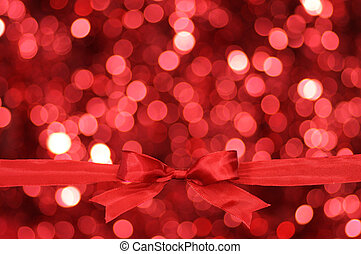Red bow with glitter background - Red ribbon and blurry...
