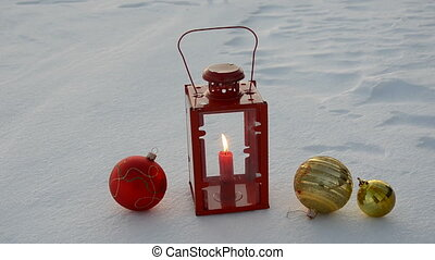 christmas balls and lamp on snow