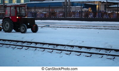 tractor at a station