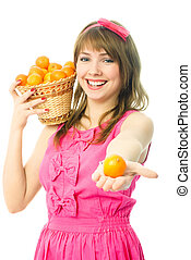 young woman with a basket full of tangerines - beautiful...