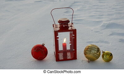 christmas toys and lamp on snow