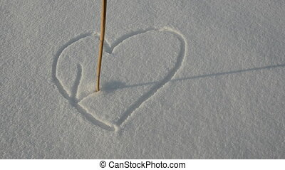 drawing love hearts on snow