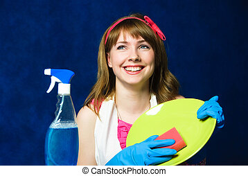 young housewife washing the dishes - beautiful young...