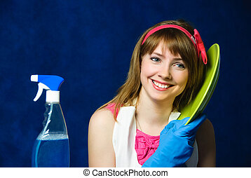 young housewife washing the dishes - portrait of a beautiful...
