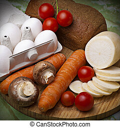 Still life from vegetables, eggs and bread