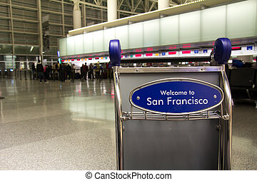 Airport luggage cart with the word welcome to San Francisco