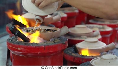Clay Pot Rice cooked over Charcoal - Cooking Clay Pot Rice...